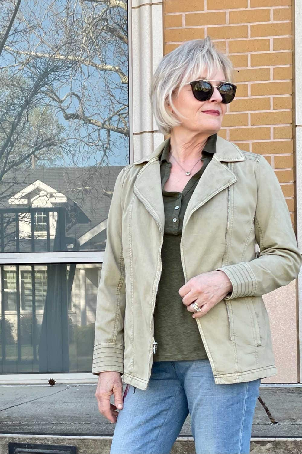 over 50 fashion blogger wearing green jacket and sunglasses