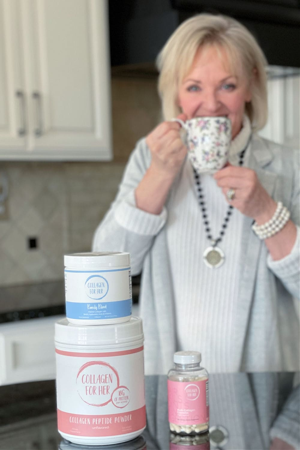 over 50 blogger jennifer connolly of a well styled life drinking tea with collagen powder added
