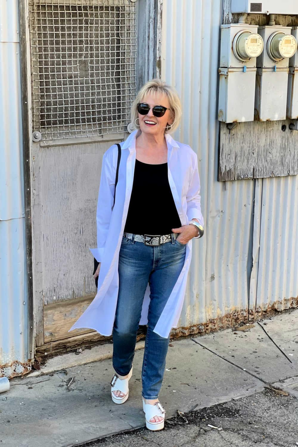 over 50 women walking in black and white outfit with blue jeans