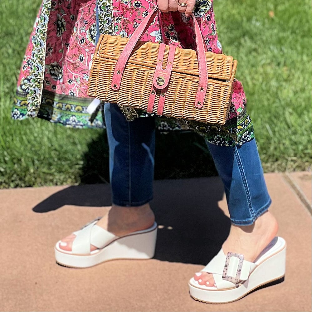 straw handbag and wedge sandals with blue jeans and kimono