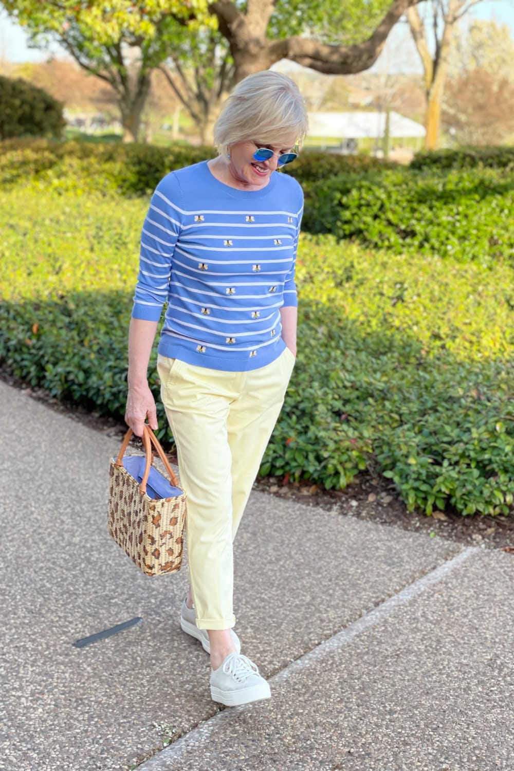 blonde lady wearing Talbots bee sweater with yellow chinos