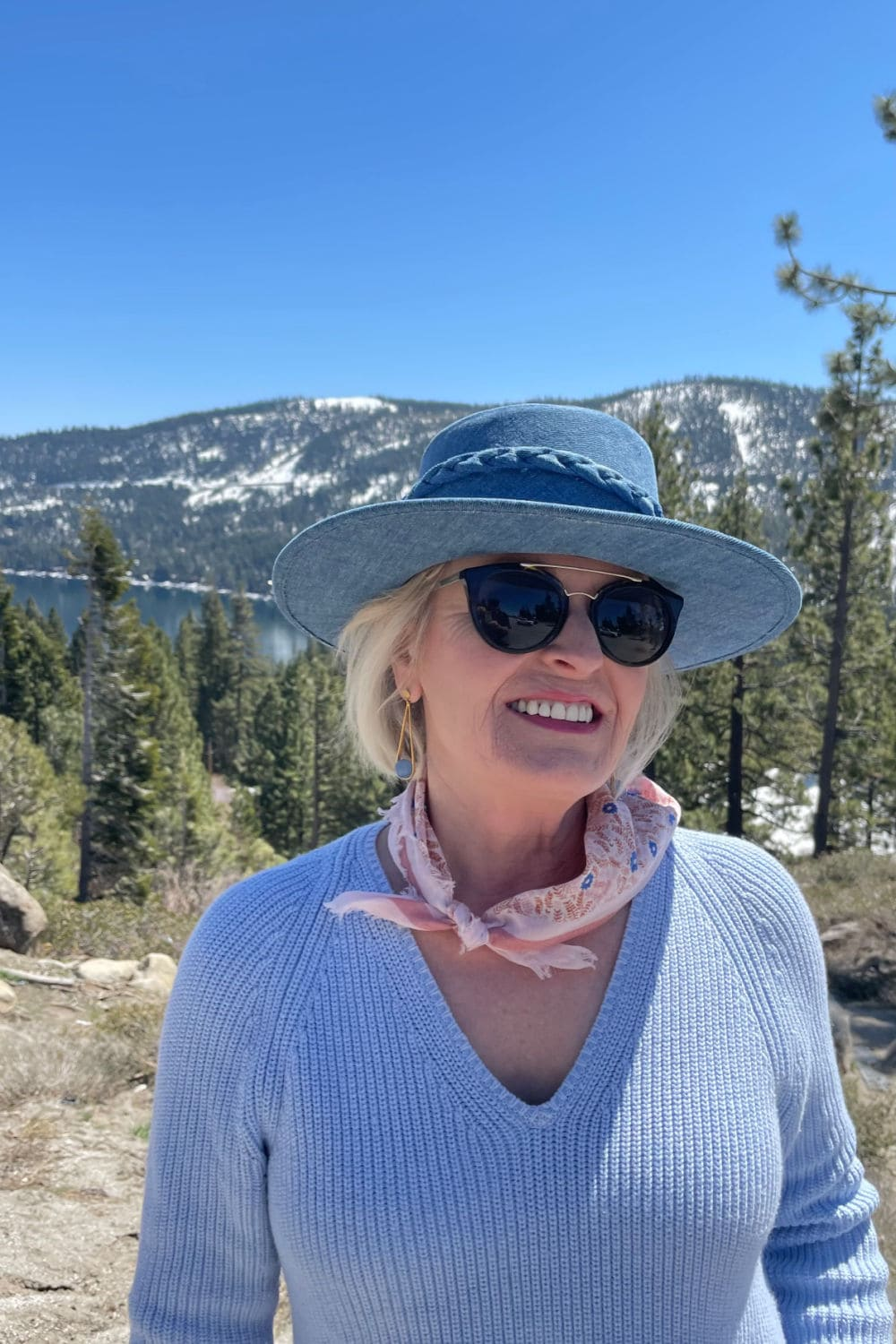 woman wearing denim hat and blue sweater