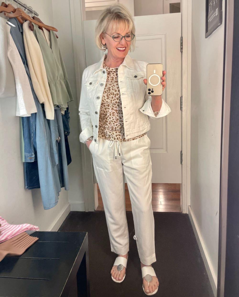 woman wearing white denim jacket and wihite jeans