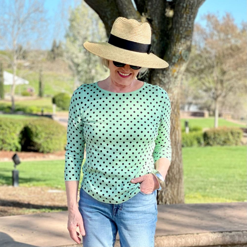 jennifer of a well styled life wearing hat and green polka dot sweater
