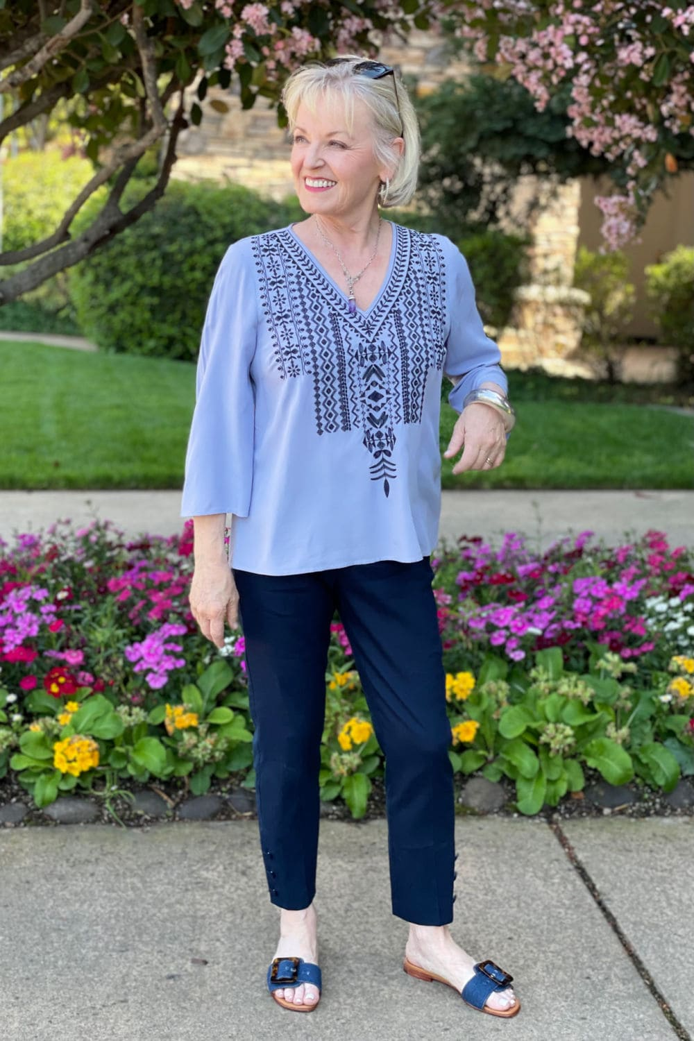 woman wearing denim shoes and boho top with navy pants