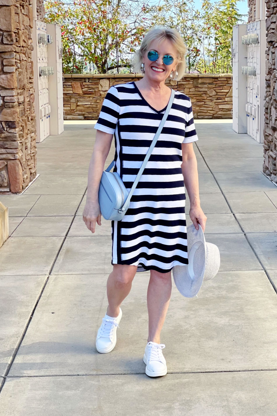 fashion blogger jennifer connolly of a well styled life wearing blue and white athleisure dress