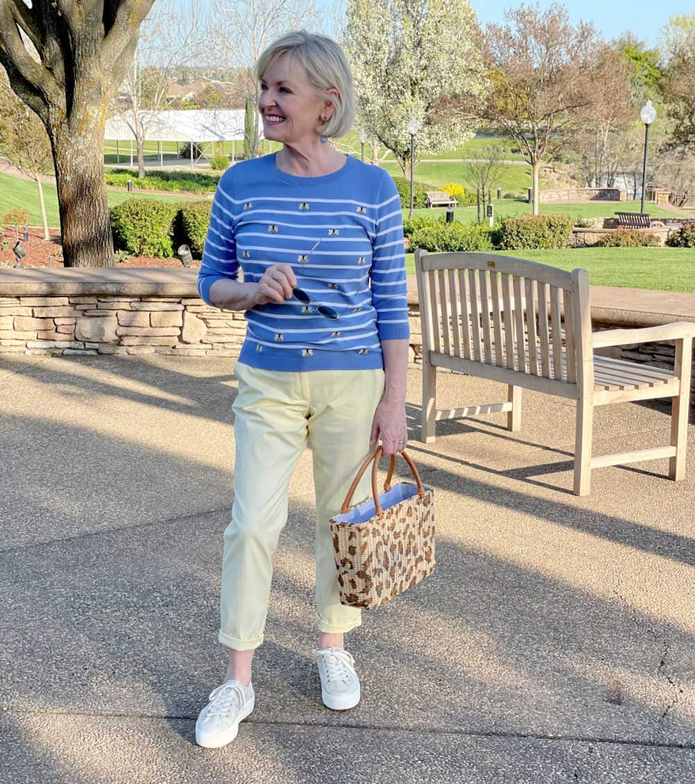 jennifer of a well styled life wearing yellow chinos and blue stripped sweater