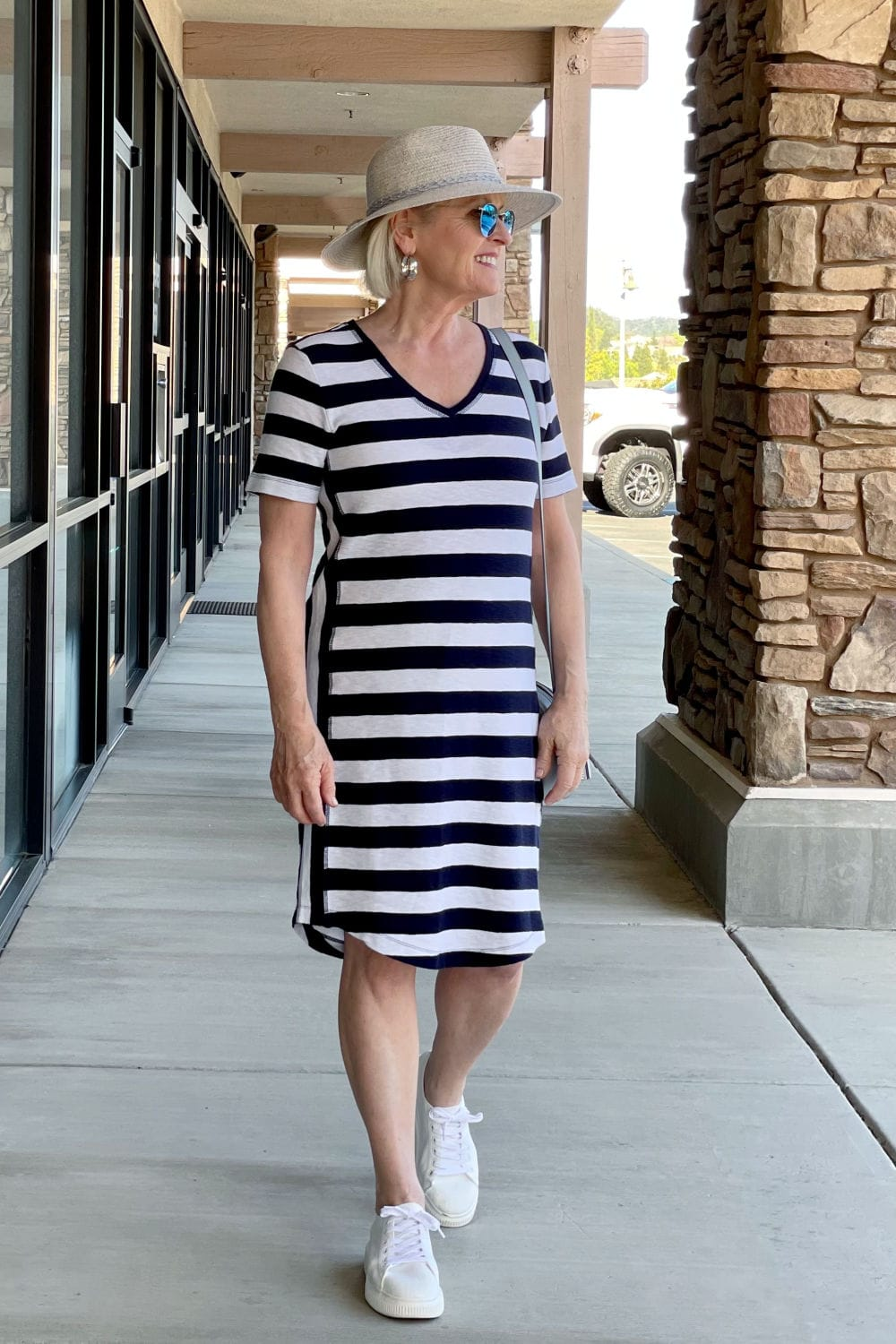 side view of striped dress on blonde woman
