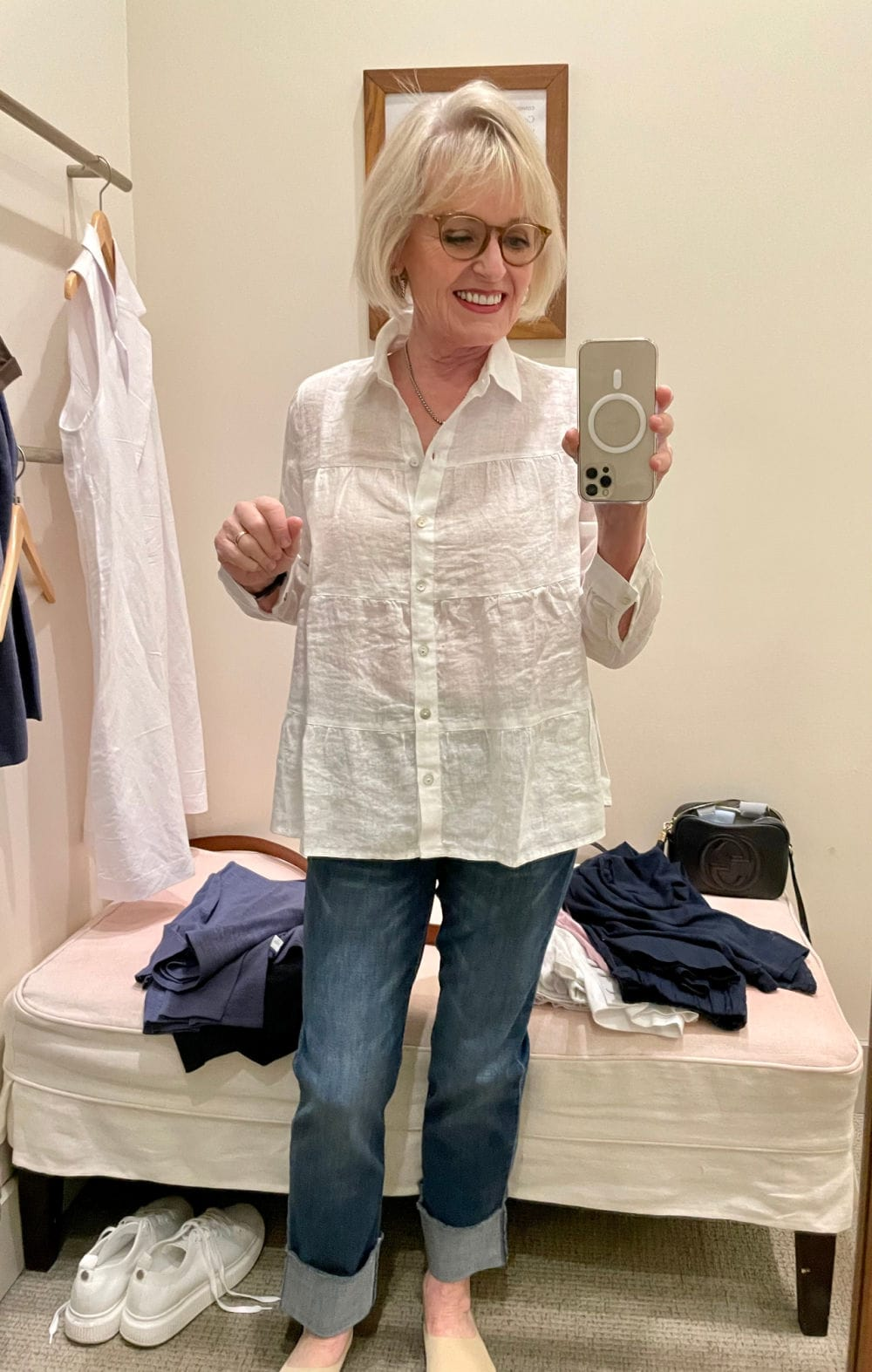 blonde woman wearing white linen shirt with cuffed jeans