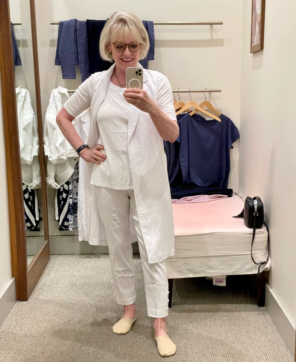 blonde woman wearing white linen tee, vest and pants