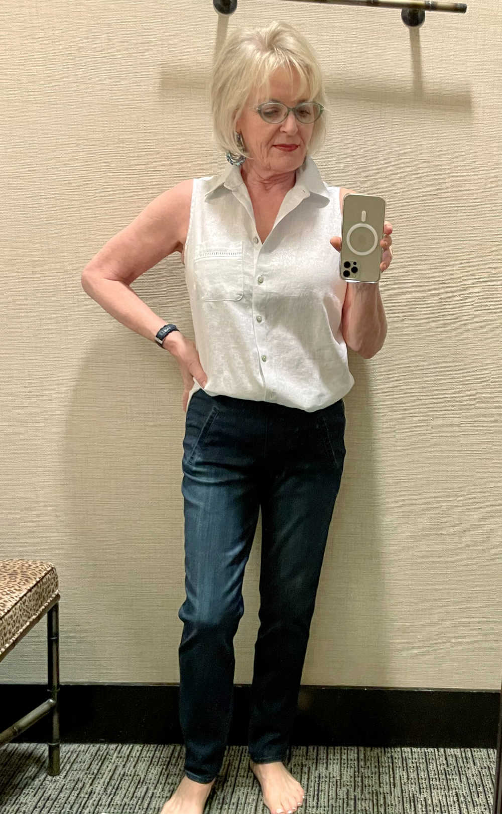 OVER 50 BLOGGER WEARING LINEN TUNIC AND DENIM JEANS