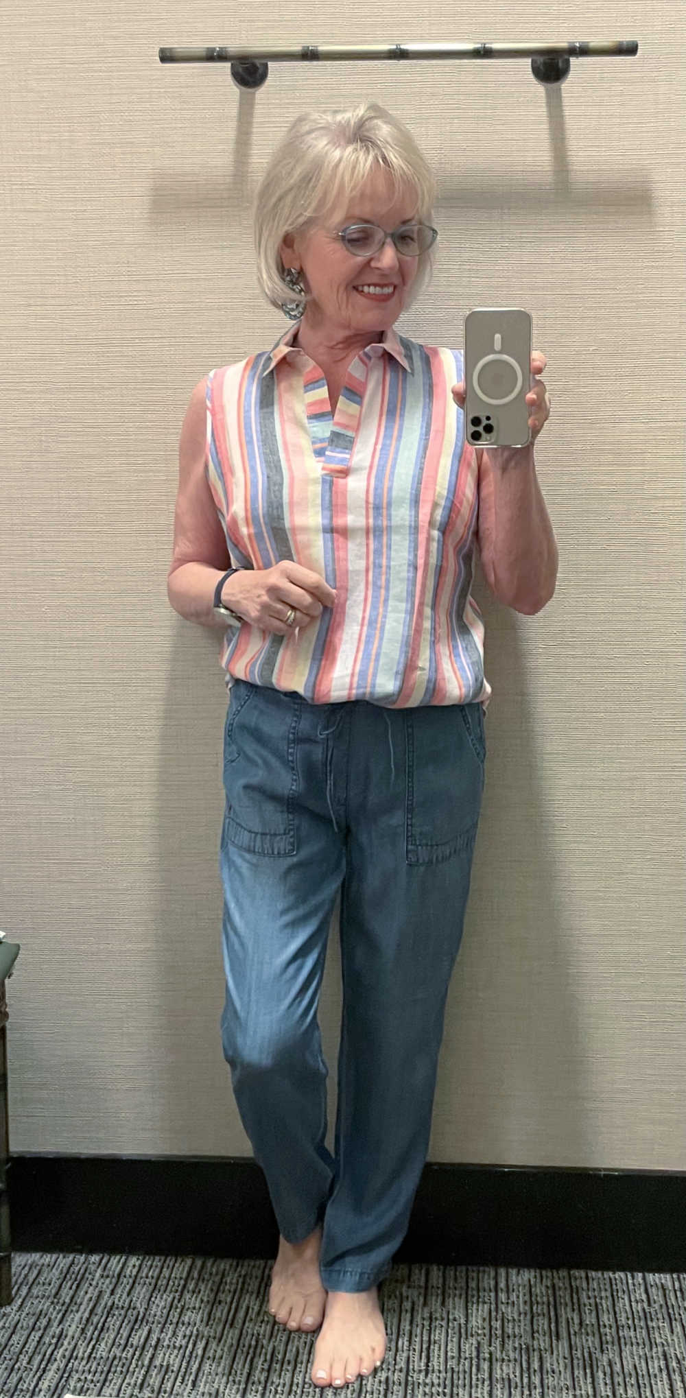 woman wearing striped shirt and chambray pants in Chicos dressing room