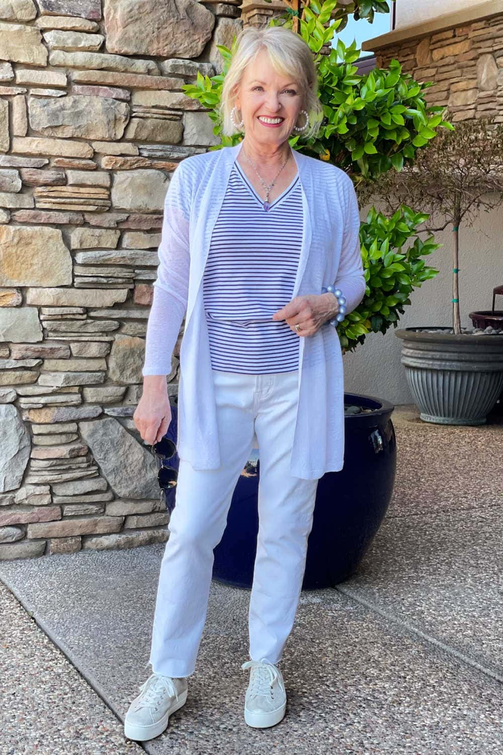 jennifer of a well styled life wearing vineyard vines strioed tee and white jeans from madewell