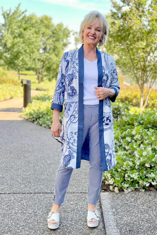 woman on path wearing blue gingham pants and blue kimono
