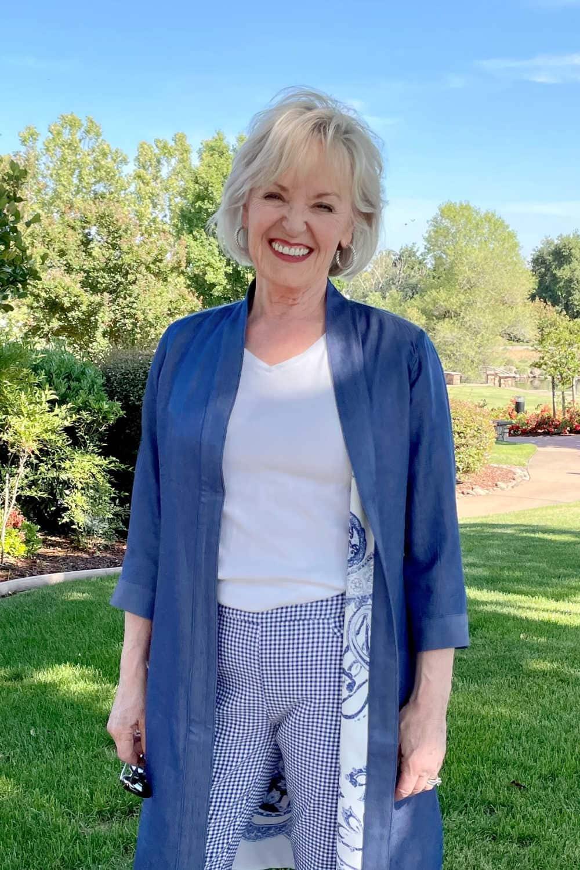 woman wearing white tee, blue kimono and plaid pants