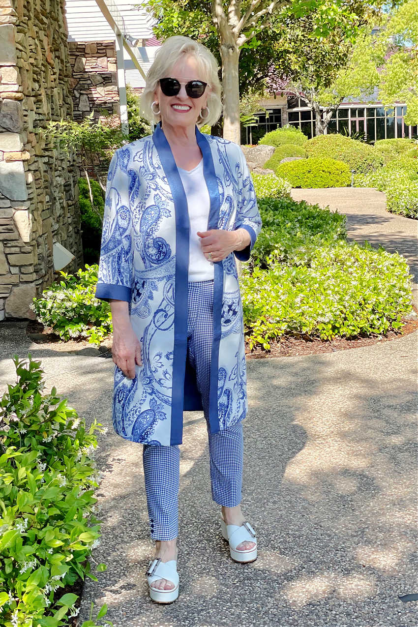 blonde woman looking at camera wearign kimono and pants in blue and white