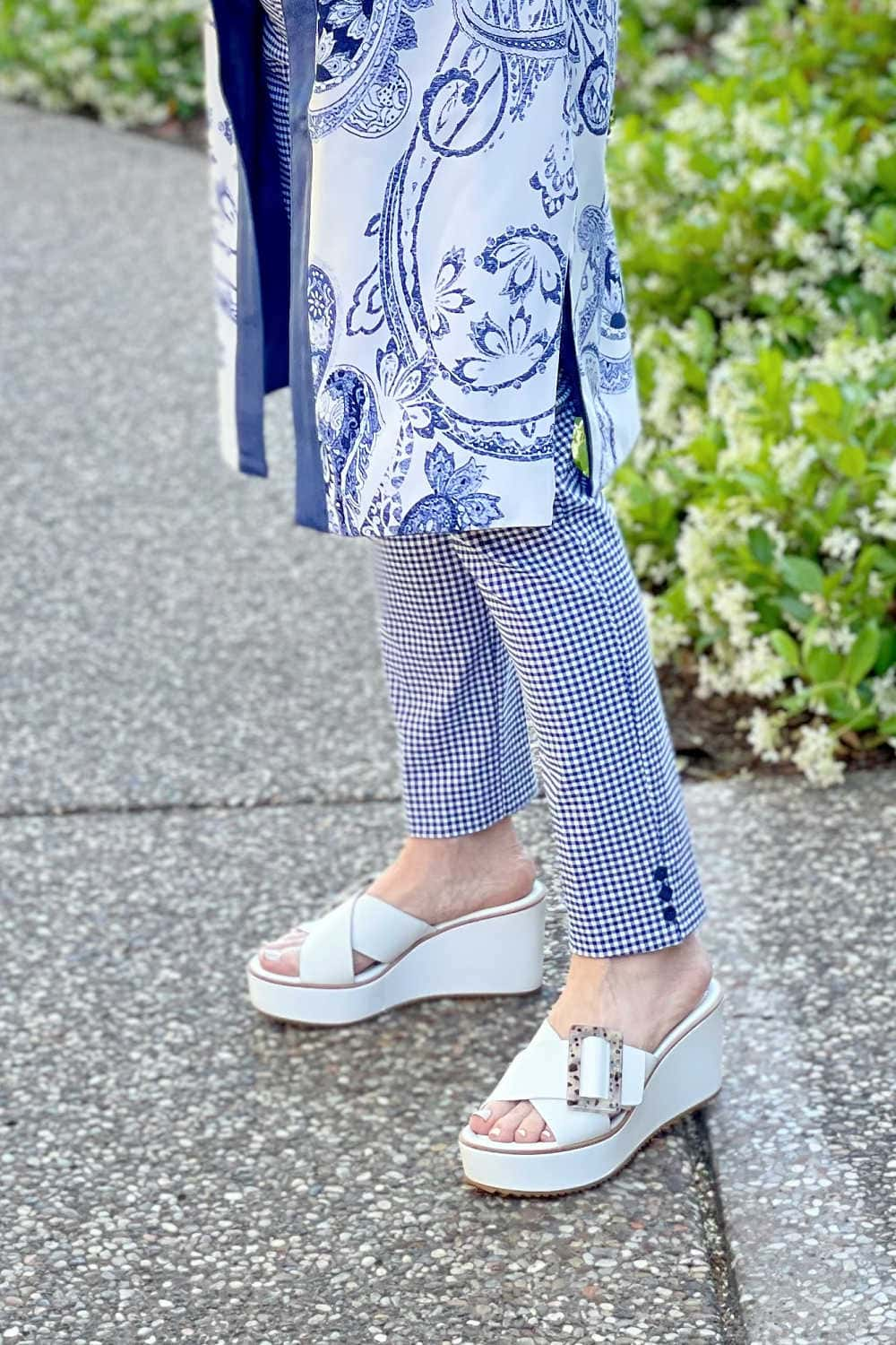 woman's legs showing blue and white jacket mixed with blue and white pants