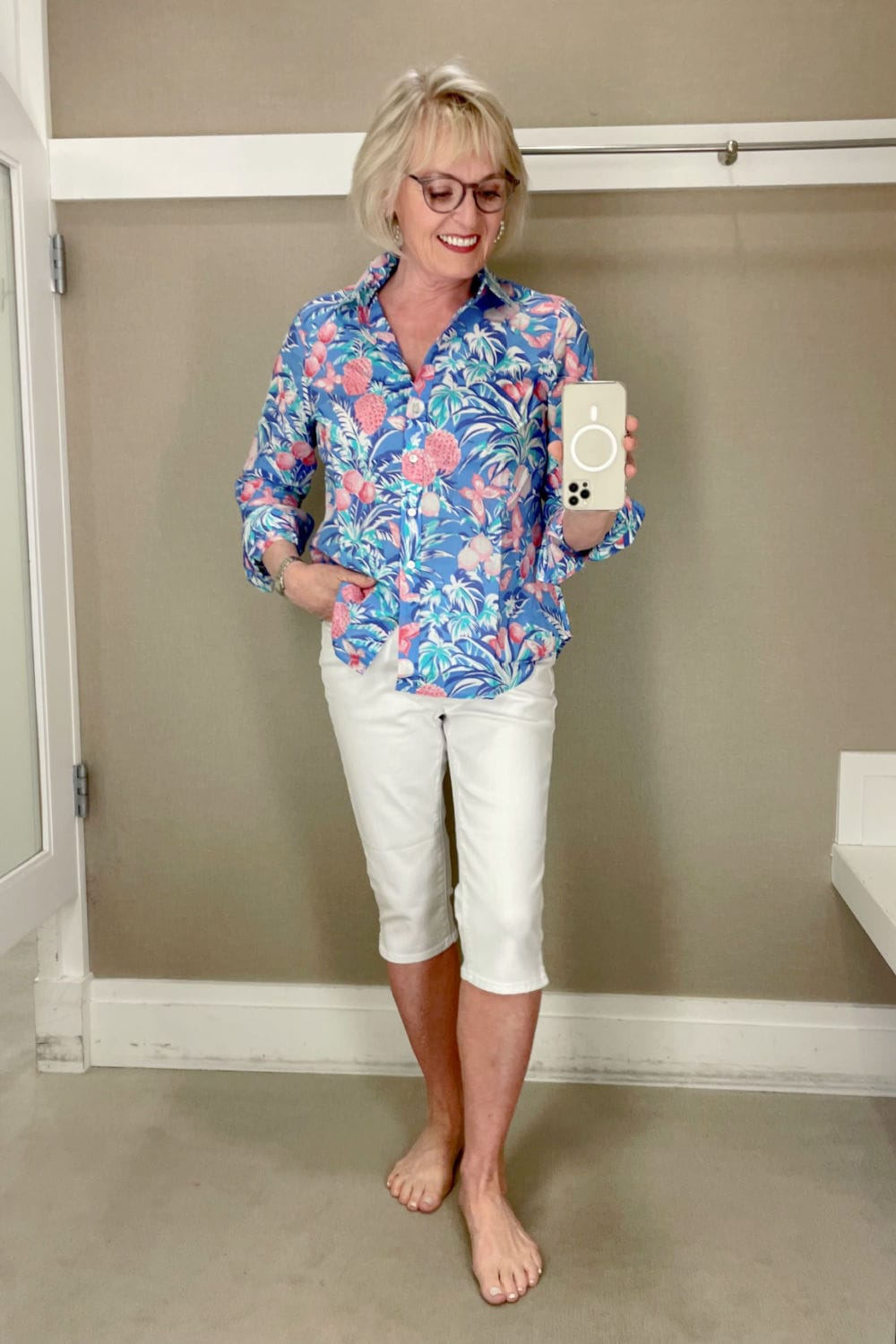 over 50 woman modeling the new white pedal pushers and floral top in Talbots dressing room