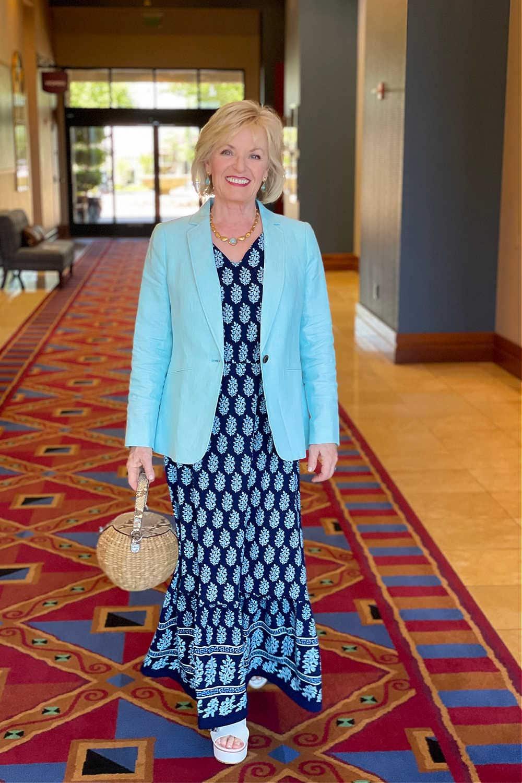blonde woman walking in hallway wearing cottom maxi dress with linen blazer