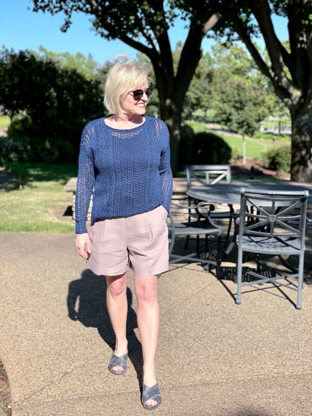 over 50 fashion blogger wearing open knit sweater and long line shorts