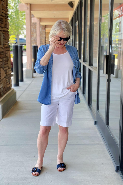 woman wearign white tee, white shorts and denim shirt