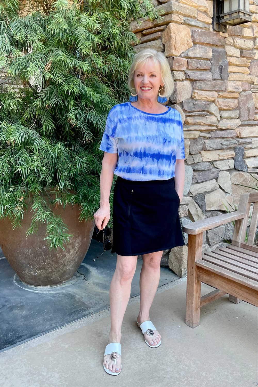 blonde woman wearingcasual skort outfit with tie dye tee