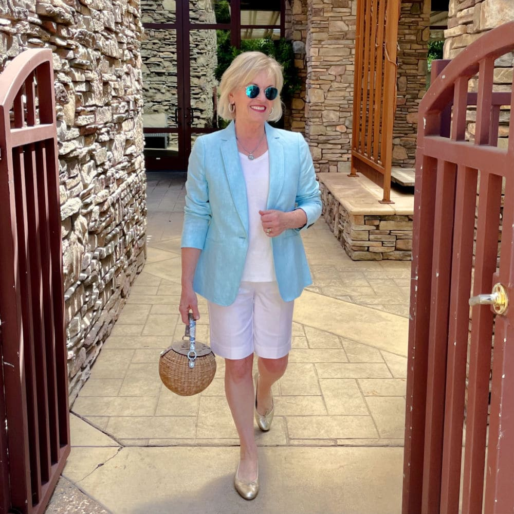 over 50 fashion blogger jennifer connolly wearing linen blazer and white shorts