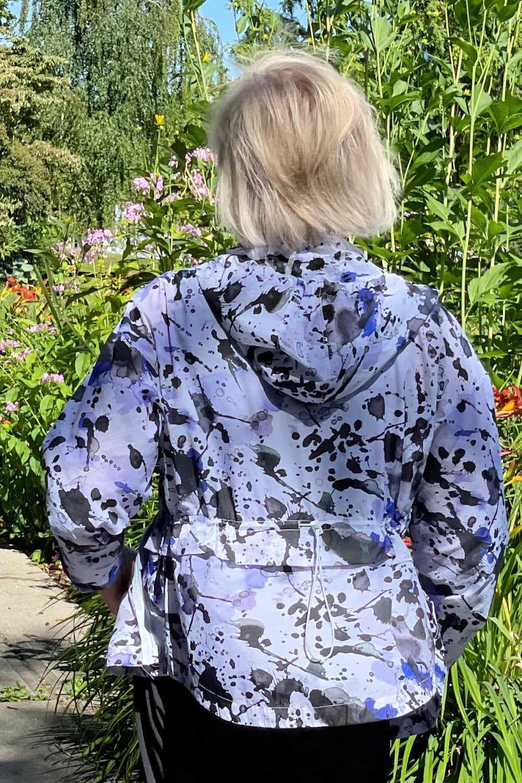 woman looking away showing back of zip hoodie
