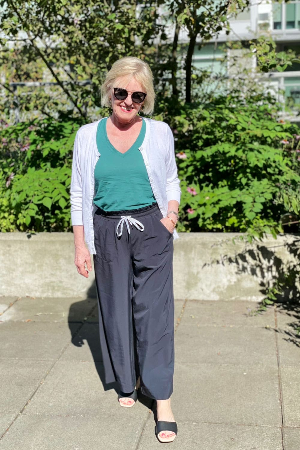 over 50 blogger showing how to dress up athletic pants