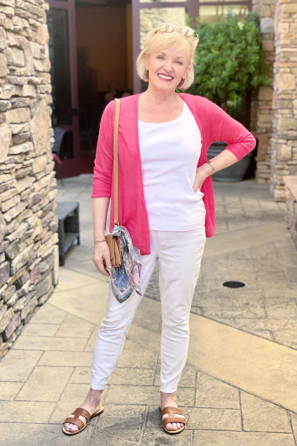 blonde woman wearing colorful cardigan now in warm weather