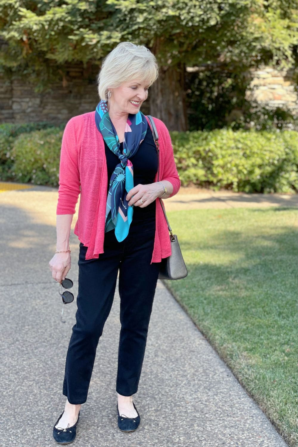 over 50 blogger jennifer connolly showing how to wear a colorful cardigan for later in the fall