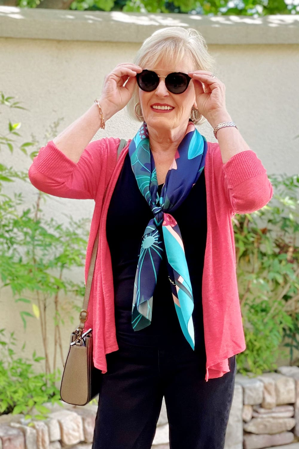 over 50 fashion blogger showing how to wear a scarf now and wear it later