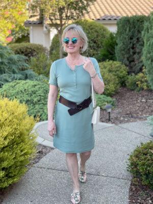 woman walking in green dress