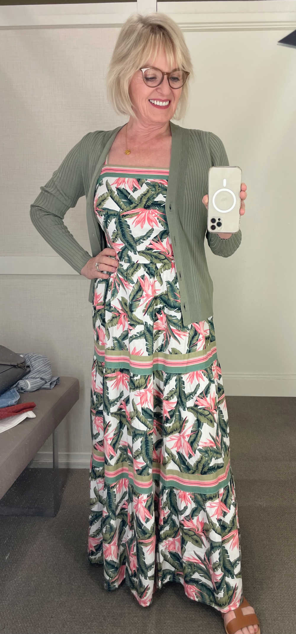 woman taking selfie in Loft dressing room mirror wearing dress with tropical print