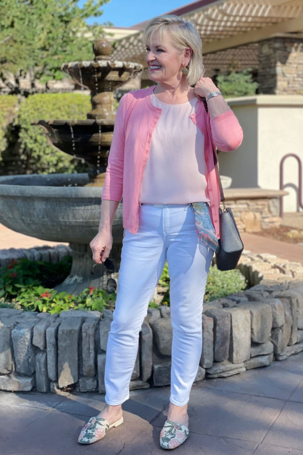 over 50 blogger jennifer of a well styled life wearing colors she loves in salmon, pink and white