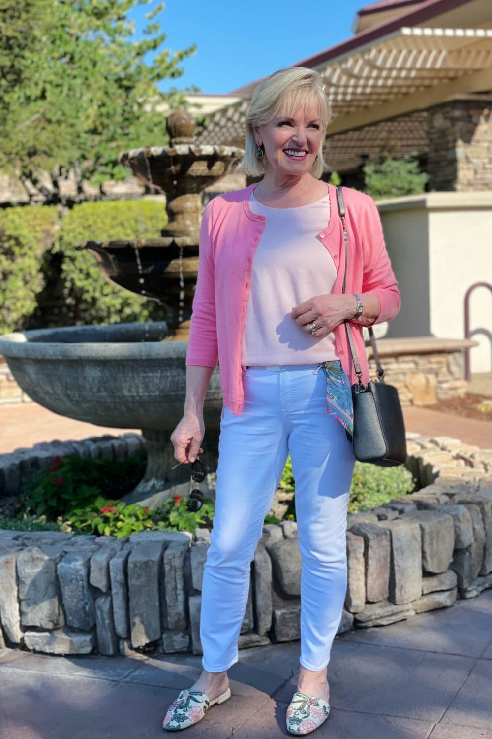 over 50 fashion blogger jennifer connolly of a well styled life wearign talboys pink cardigan with chicos white jeans