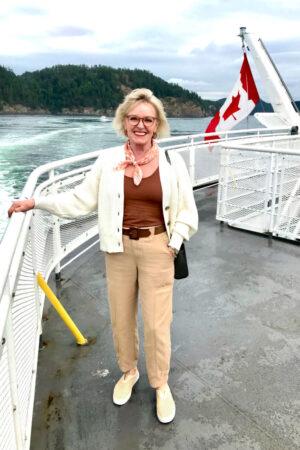 women wearing feminine cargo pants and sweater on ferry