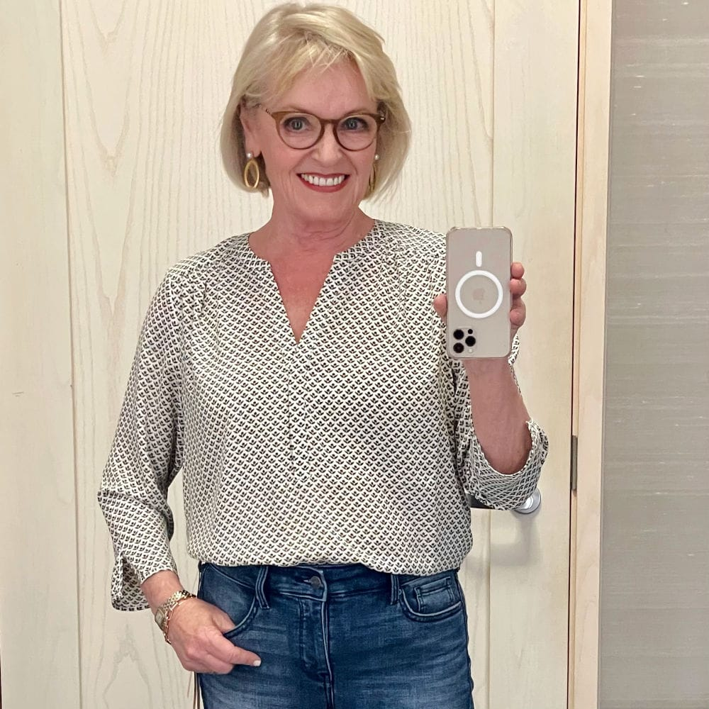 woman in dressing room selfie wearing soft blouse outfit