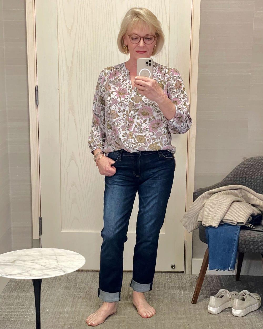 woman showing half tuck in dressing room selfie