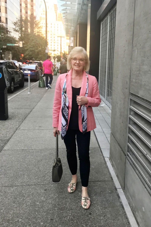 woman walking down sidewalk in Vancouver wear Talbots blazer over column of black