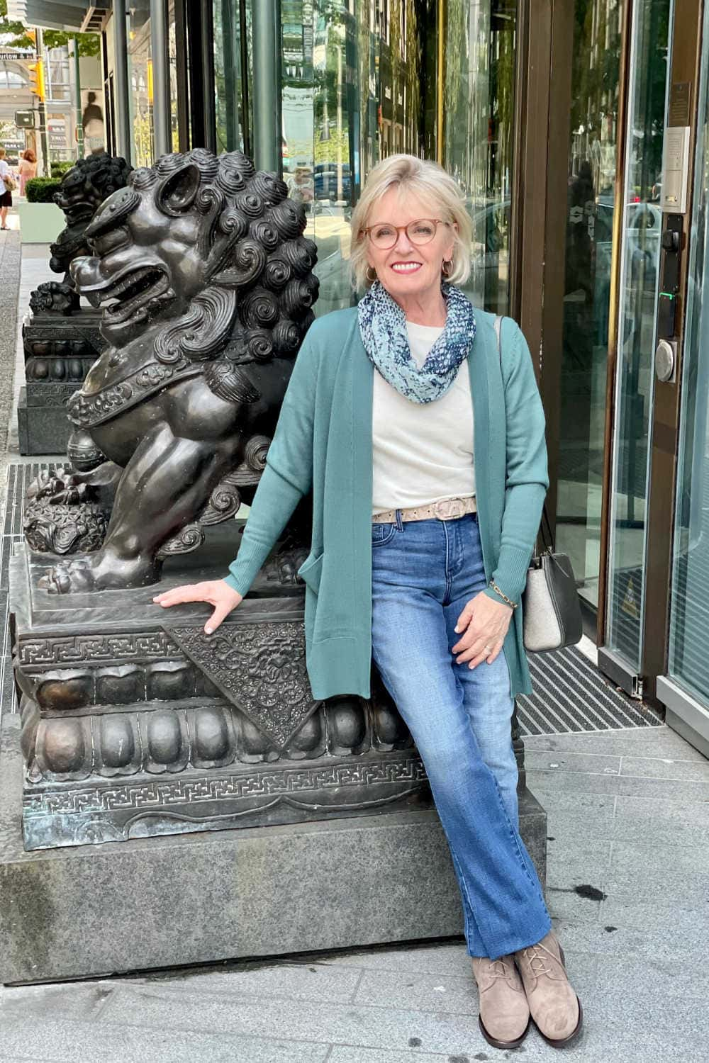 woman wearing sweater and denim from the nsale