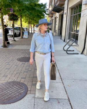 woman walking down the street carrying a bag from Murchies tea shop