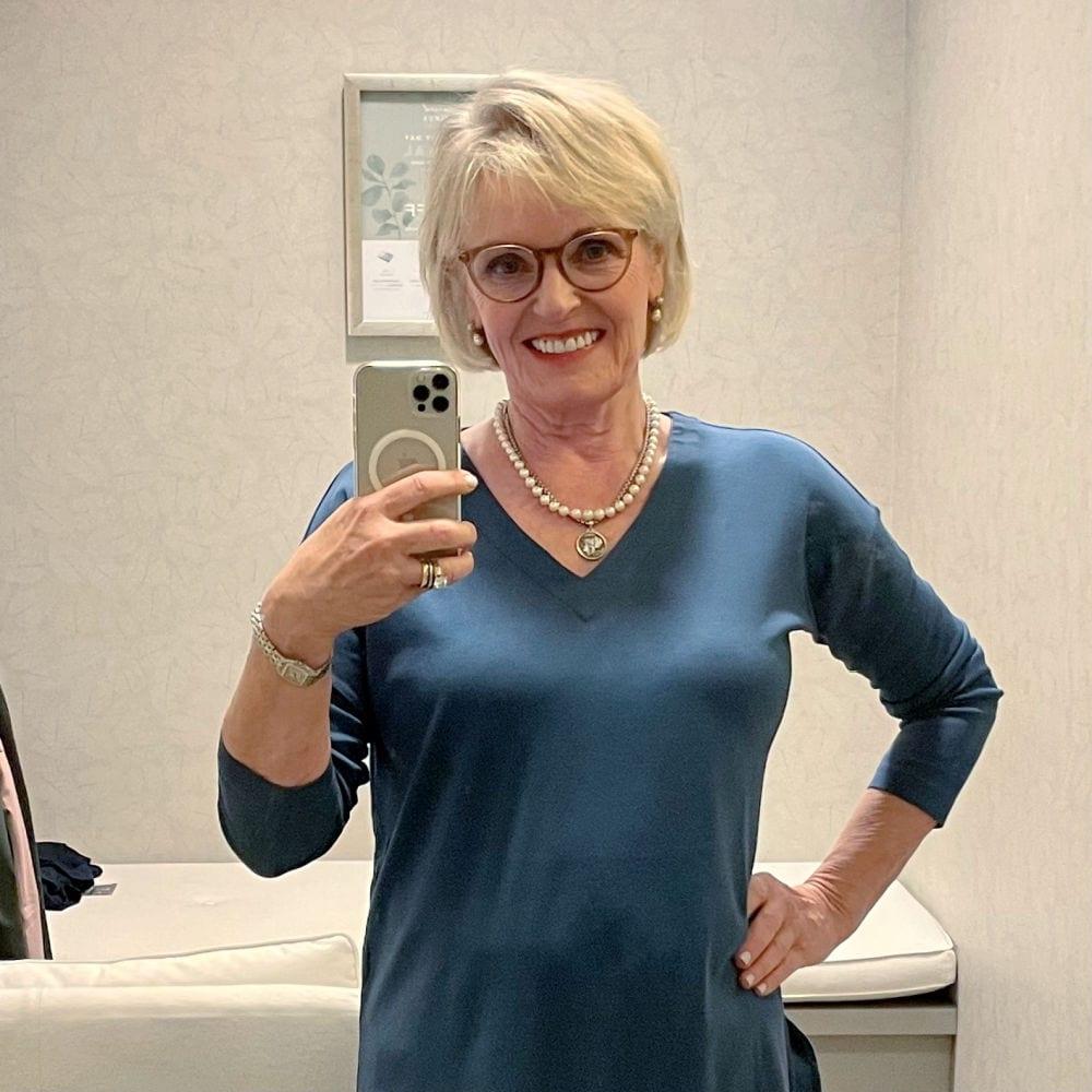 WOMAN WEARING NEWEST BLUE TUNIC IN J.JILL DRESSING ROOM