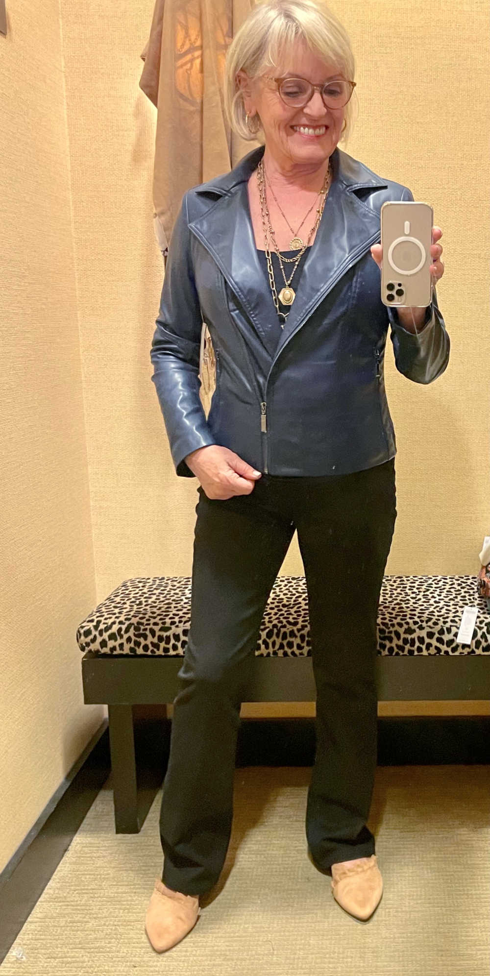 WOMAN WEARING BLUE FAUX LEATHER JACKET FROM CHICO'S