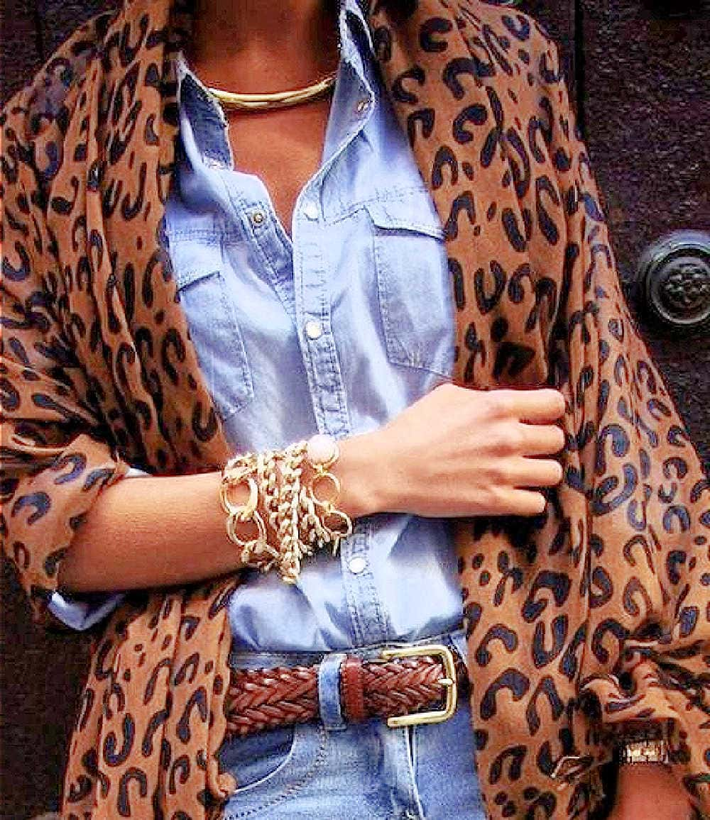 showing personal style combining leopard print with denim and multiple bracelets