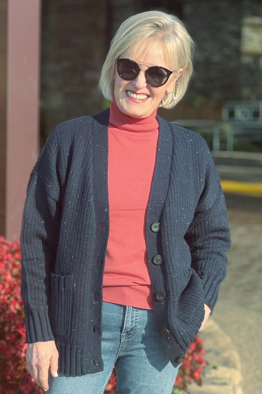 woman wearing free assembly grandpa sweater