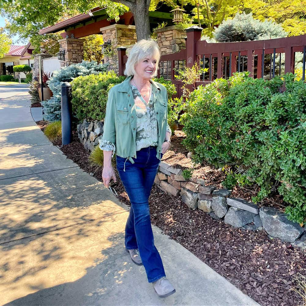 woman walking lightweight fall outfit of bootcut jeans and suede booties from Nordstrom