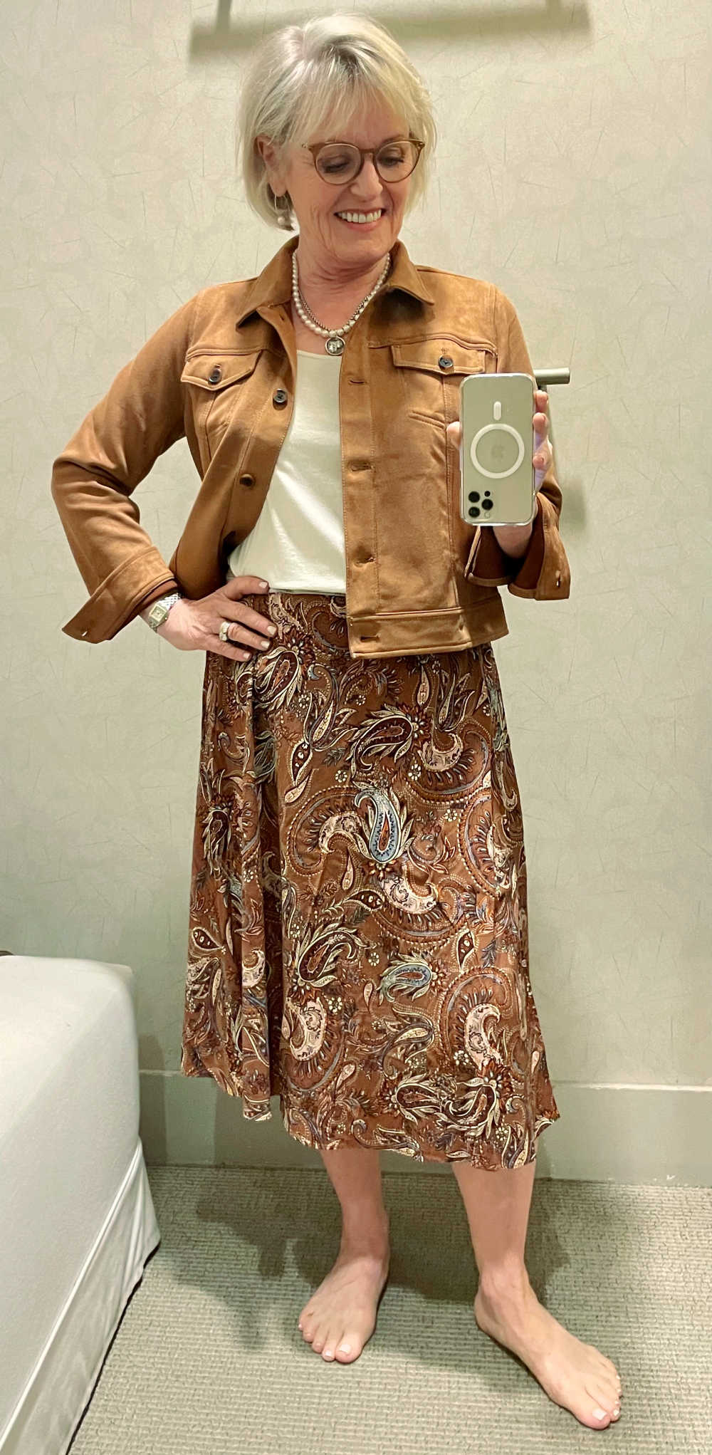 woman wearing print midi skirt and faux suede jacket by J. Jill