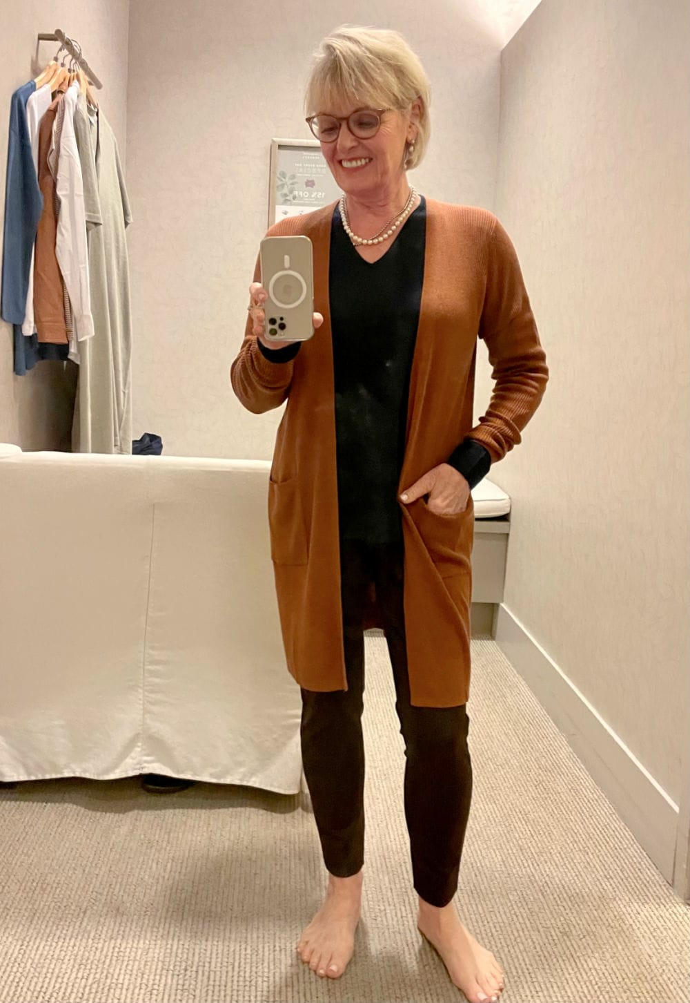 WOMAN WEARING RUST COLORED CARIGAN OVER NAVY SWEATER AND PONTE LEGGINGS FROM NEW J JILL COLLECTION