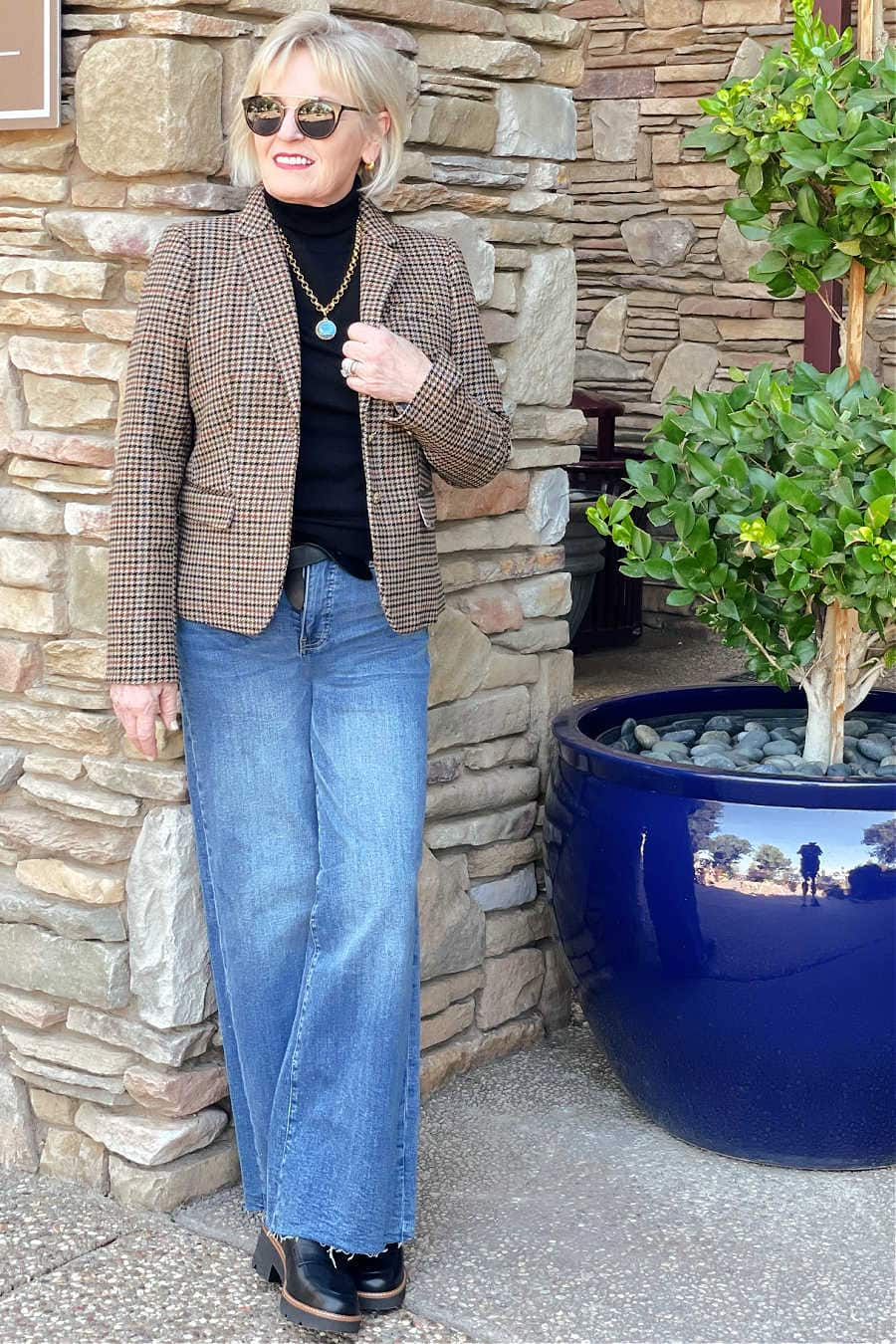 over 50 fahsion blogger jennifer connolly of a well styled life wearing trendy wide jeans and loafers